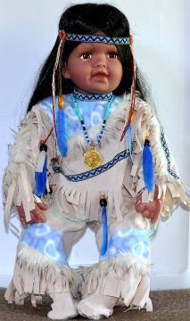 Sacagawea Pomp Dolll wearing a Sacagawea Gold Dollar Necklace